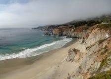 Big Sur California coast, bridge, beach, rocks, clouds, and surfing waves stock photos
