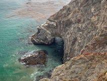Big Sur California coast, bridge, beach, rocks, clouds, and surfing waves stock photography