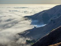 Big Sur California coast, bridge, beach, rocks, clouds, and surfing waves royalty free stock photo