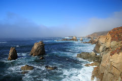 Big Sur, California. Rocks and waves of California coast, near Big sur on a foggy day Royalty Free Stock Photography