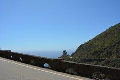 Big Sur Central Coast California gorgeous coastline. Rocky coastline with aqua blue pacific ocean and scenic coastal highway 1. stone work half domes guard rail Royalty Free Stock Photography