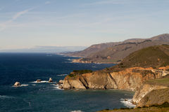 Big Sur Coastline and Bridge. The perfect rugged coastline along highway 1 in Big Sur California. One of the massive bridges can be seen, and the deep blue ocean Royalty Free Stock Image