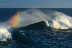 Big surf wave breaking, with rainbow colours Stock Images