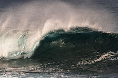 Big surf wave curling into a barrel Royalty Free Stock Photos
