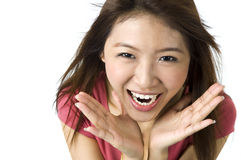 Big surprise. Asian young woman looking surprised against white background stock image