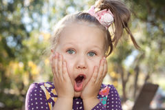 Big surprise. Portrait of a very surprised little girl Stock Photography