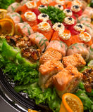 Big sushi set with green salad and orange Royalty Free Stock Photo