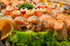 Big sushi set with green salad and orange Stock Images