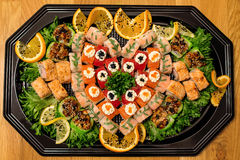 Big sushi set with green salad and orange Stock Photography