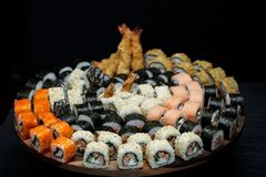 Big sushi set with shrimps, eel and salmon. Stock Photos