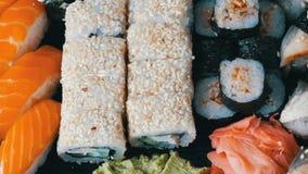 Big sushi set with variety of sushi rolls, maki, nigiri, gunkan close up. View stock video footage