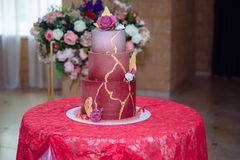 Big sweet multilevel wedding cake decorated with flowers. Concept of candy bar on party Stock Photo