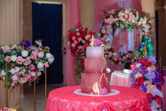 Big sweet multilevel wedding cake decorated with flowers. Concept of candy bar on party Royalty Free Stock Photos