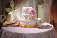 Big sweet multilevel wedding cake decorated with flowers. Concept of candy bar on party Royalty Free Stock Image