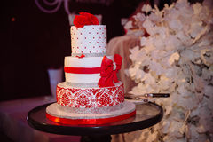 Big sweet multilevel wedding cake decorated with flowers. Concept of candy bar on party Stock Photography