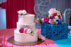Big sweet multilevel wedding cake decorated with flowers. Concept of candy bar on party.  Royalty Free Stock Photography