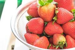 Big sweet strawberries in metal bowl Royalty Free Stock Photos