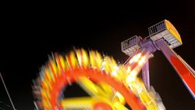 Big swing pendulum ride at night stock footage