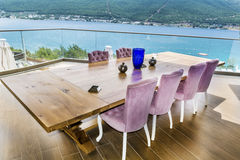 Big table in  restaurant with sea view Stock Photos