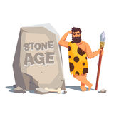 Big tablet rock with leaning caveman Stock Photos