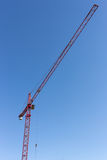 Big tall construction crane Stock Images