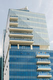 Big tall glass dubai middle east building in a hazy cool weather setting. Royalty Free Stock Photo