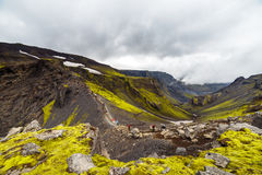 Big tall hill with are climbing up tourists in Iceland royalty free stock images