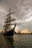 Big Tallship in port at sunset. A Tallship in the harbour at sunset Stock Image