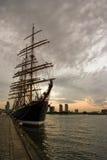 Big Tallship in port at sunset Stock Image
