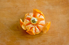 Big tangerine. On a cutting board Royalty Free Stock Images