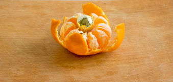 Big tangerine. On a cutting board Royalty Free Stock Photo