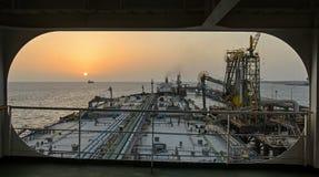 A big tanker is discharging oil Stock Image