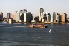 A big tanker passing by Hudson river and New Jersey skyline.  Royalty Free Stock Image