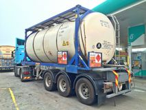 Big tanker truck. A tank truck carrying methanol stops by at a petrol station for refuelling in Peninsular Malaysia stock photography