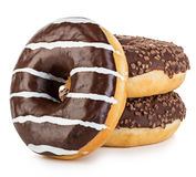 Big tasty appetizing donuts isolated close-up on a white background Royalty Free Stock Images