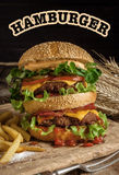 Big Tasty burger with beef and fried potatoes. Stock Photo