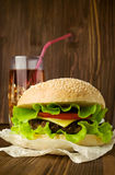 Big tasty cheeseburger with cola Royalty Free Stock Images
