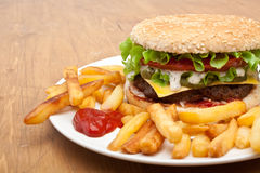 Big tasty cheeseburger with french fries Stock Image