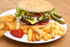 Big tasty cheeseburger with french fries Stock Photography