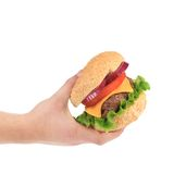 Big tasty hamburger in hand. Stock Images