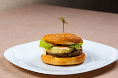 Big and tasty hamburger with pineapple Royalty Free Stock Photography