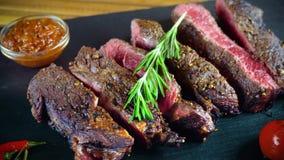 Big tasty steak on stone plate stock video footage