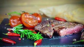Big tasty steak on stone plate stock video