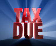 Big Tax Due. Gold TAX DUE on a dark blue background brilliantly backlit with light rays shining through Stock Image
