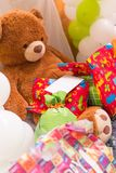 Teddy Bear, Wrapped Presents and Balloons with White Card stock photography