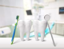 Big teeth, toothbrush and dentist mirror in Royalty Free Stock Images