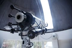 Big telescope under dome of astronomic observatory. S s s Stock Photos