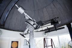 Big telescope under dome of astronomic observatory. S s s Royalty Free Stock Image