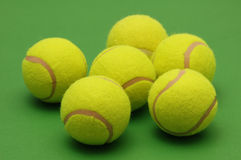 Big tennis balls on the green background. Big tennis balls  on the green background Royalty Free Stock Photos