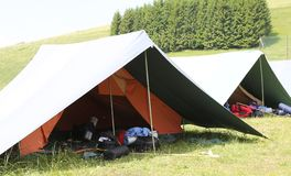 Big tent of boy scout camp with backpacks Royalty Free Stock Photography